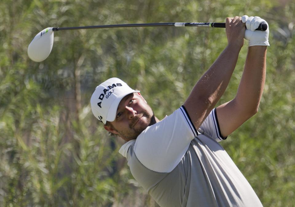 Ryan Moore tees off the sixth hole during the third round of the Justin Timberlake Shriners Hospitals for Children Open golf tournament, Saturday, Oct. 6, 2012, in Las Vegas. (AP Photo/Julie Jacobson)