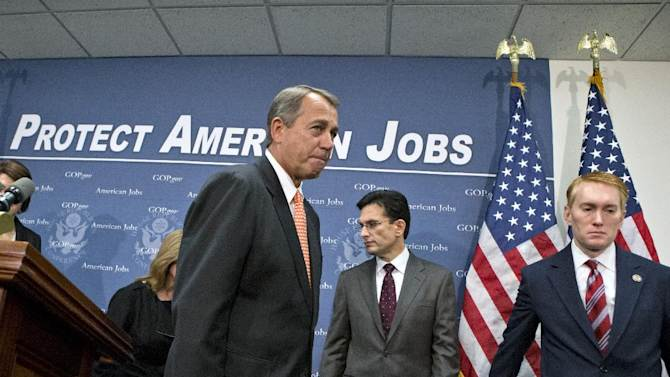 """House Speaker John Boehner of Ohio, leaves after a news conference on Capitol Hill in Washington, Wednesday, Dec. 12, 2012, following the GOP caucus. Boehner and the other House Republican leaders are calling for Obama to come up with plan they can accept for spending cuts and tax revenue to avoid the so-called """"fiscal cliff"""" of automatic tax hikes and budget reductions. From left are, Rep. Cathy McMorris Rodgers, R-Wash., Rep. Marsha Blackburn, R-Tenn., Boehner, House Majority Leader Eric Cantor of Va. and Rep. James Lankford, R-Okla. (AP Photo/J. Scott Applewhite)"""