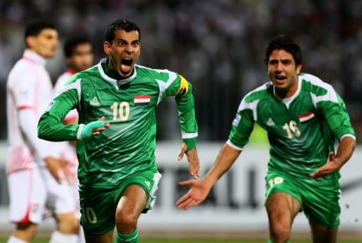 Younus Mahmoud (L) of Iraq celebrates with teammate Mohanad Abdulraheem after scoring a goal against United Arab Emirates during their 21st Gulf Cup football match final in Manama, on January 18, 2013