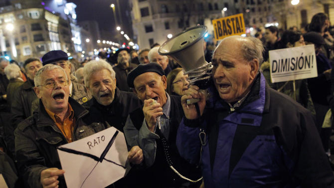 """Protestors shouts slogans as they hold an envelope during a demonstration against corruption, in Madrid, Spain, Thursday, Jan. 31, 2013. Spain's governing Popular Party insists its financial accounts are totally legal and denies a newspaper report of regular under-the-table payments to leading members, including current Prime Minister Mariano Rajoy. The scandal first broke when after the National Court reported that former party treasurer Luis Barcenas amassed an unexplained euro 22 million ($30 million) in a Swiss bank account several years ago. In a statement Thursday Jan. 31, 2013, the party denied the existence of """"hidden accounts"""" or """"the systematic payment to certain people of money other than their monthly wages. (AP Photo/Andres Kudacki)"""