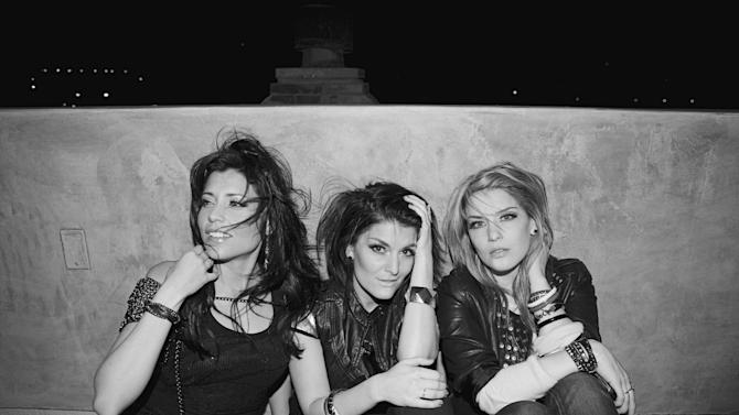 "This undated photo provided by Warner Music Group/Word Entertainment shows the platinum-selling music trio BarlowGirl, from left, Becca Barlow, Alyssa Barlow and Lauren Barlow. The band is retiring after they release their final single, ""Hope Will Lead Us On,"" on Oct. 30, 2012. (AP Photo/Warner Music Group/Word Entertainment, Sarah Barlow)"