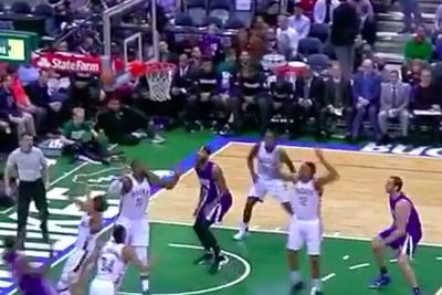Rajon Rondo's shot deflects off the side of the backboard and becomes a perfect assist