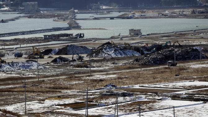 This Saturday, Feb. 23, 2013 photo shows an area devastated by the March 11, 2011 earthquake and tsunami, in Rikuzentakata, Iwate Prefecture, northeastern Japan. Japan's progress in rebuilding from the March 11, 2011 tsunami that thundered over coastal sea walls, sweeping entire communities away and killing more than 19,000 people, is mainly measured in barren foundations and empty spaces. (AP Photo/Junji Kurokawa)