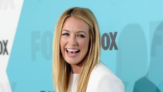 "FILE - This May 14, 2012 file photo shows Cat Deeley, host of ""The Choice"" and ""So You Think You Can Dance"" at the FOX network upfront presentation party at Wollman Rink in New York. ""The Choice,"" premiering Thursday at 9 p.m. EST on Fox, essentially pairs real people with celebrities. (AP Photo/Evan Agostini, file)"