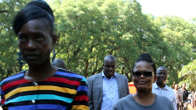 Human rights lawyer, Beatrice Mtetwa, right, arrives at court in Harare, Tuesday, March 19, 2013. Police have charged Mtetwa for obstructing justice after ignoring a judge's order to release her a day earlier. Mtetwa was arrested Sunday while representing four opposition members of the prime minister's party while  undergoing police searches. (AP Photo)