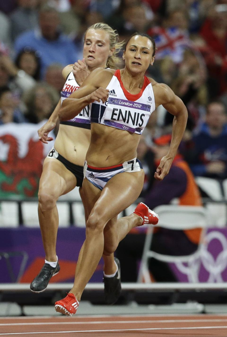 Britain's Jessica Ennis, right, and Canada's Brianne Theisen compete in a 200-meter heptathlon during the athletics in the Olympic Stadium at the 2012 Summer Olympics, London, Friday, Aug. 3, 2012. (AP Photo/Ben Curtis)