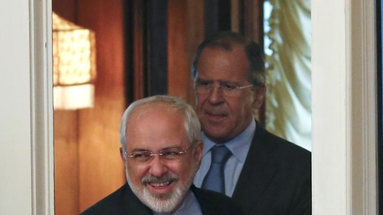 Iranian Foreign Minister Mohammad Javad Zarif and his Russian counterpart Sergei Lavrov walk into a hall during a meeting in Moscow