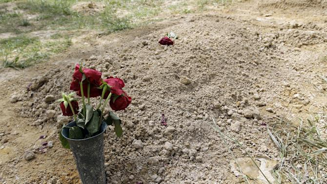 Flowers are placed on the alleged burial site of Boston Marathon bombing suspect Tamerlan Tsarnaev in Doswell, Va., Friday, May 10, 2013. Tsarnaev's uncle Ruslan Tsarni said Tsarnaev was buried in the cemetery in Doswell, near RichmondVa.Tsarnaev was killed April 19 in a getaway attempt after a gunbattle with police. His younger brother, Dzhokhar, was captured later and remains in custody.(AP Photo/Luis M. Alvarez)