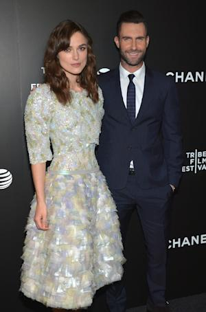 """Keira Knightley, left, and Adam Levine arrive at the premiere of """"Begin Again"""" at the Tribeca Film Festival on Saturday, April 26, 2014, in New York. (Photo by Evan Agostini/Invision/AP)"""