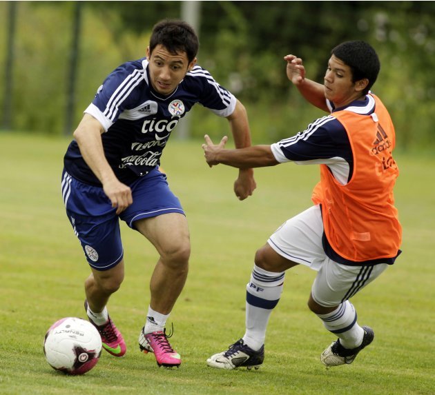 Paraguay's Ivan Piris takes part in a training session in Ypane, near Asuncion