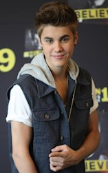 FILE - In this June 11, 2012 file photo, pop star Justin Bieber poses for photos prior to a press conference at a hotel in Mexico City. A Los Angeles judge ruled Wednesday, Nov. 14, 2012, that an anti-paparazzi law is overly broad and dismissed those charges against a photographer accused of recklessly chasing Justin Bieber. (AP Photo/Alexandre Meneghini, File)