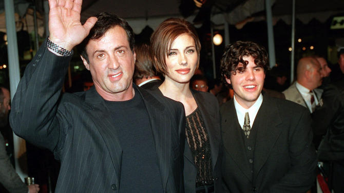 """FILE - In this Dec. 5, 1996 file photo, Sylvester Stallone, left, star of the film """"Daylight,"""" arrives at the film's world premiere with his girlfriend Jennifer Flavin, center, and his son Sage Stallone, who co-stars in the film, in Hollywood district of Los Angeles. Coroner's officials determined Thursday, Aug. 30, 2012 that Sage Stallone died from a heart condition that causes blockage of the arteries and his death has been determined to be from natural causes. (AP Photo/Kevork Djansezian, File)"""