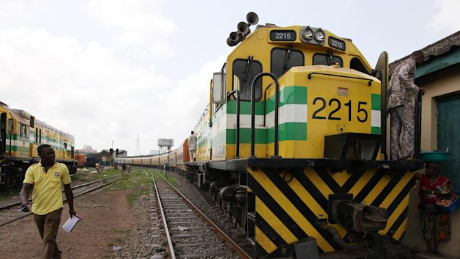 In this Photo taken, Friday, March . 8, 2013, A man walks past an Ooni of Ife train to Kano,  at a terminal in Lagos, Nigeria.   Nigeria reopened its train line to the north Dec. 21, marking the end of a $166 million project to rebuild portions of the abandoned line washed out years earlier. The state-owned China Civil Engineering Construction Corp. rebuilt the southern portion of the line, while a Nigerian company handled the rest.  ( AP Photo/Sunday Alamba)