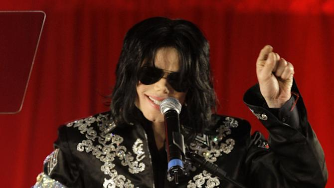 FILE - In this March 5, 2009 file photo, Michael Jackson announces several concerts at the London O2 Arena in July, at a press conference at the London O2 Arena. Jackson's longtime makeup artist tearfully described to jurors in a Los Angeles courtroom on Thursday, May 9, 2013, the singer's struggles with back pain and insomnia after suffering injuries during his career. Witness Karen Faye also recalled how Jackson's reliance on medications coincided with the first time he was accused of child molestation in the early 1990s. (AP Photo/Joel Ryan, file)