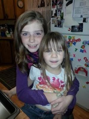 This undated family photo provided by the Pershing County Sheriff's Office shows Shelby Fitzpatrick, left, and Chloe Glanton. Rescue teams were working against the clock and the brutal cold Monday, Dec. 9, 2013, in the search for a missing couple and four children who went to play in the snow in the remote mountains of northwest Nevada but didn't return after a night of sub-zero temperatures. Pershing County deputies said aircraft and crews on the ground were searching in the mountains about 100 miles northeast of Reno for 34-year-old James Glanton, his 25-year-old girlfriend, Christina McIntee, and the four children: a 10-year-old, two 4-year-olds and a 3-year-old. (AP Photo/Family Photo via Pershing County Sheriff's Office)