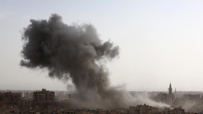 Smoke billows from the Syrian rebel-held area of Douma, east of the capital Damascus, following a reported air strike by government forces on September 16, 2015