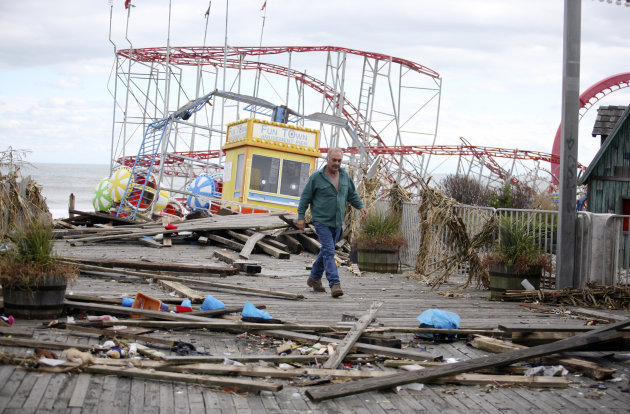 The Fun Town Pier in Seaside Heights has been heavily damaged. Owner Billy Major surveys the damage Wednesday, Oct. 31, 2012. Only four of the rides on the pier survived superstorm Sandy. (AP Photo/St