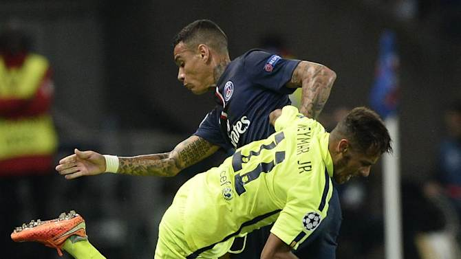 Paris Saint-Germain defender Gregory Van der Wiel clashes with Barcelona's Neymar (front) during their UEFA Champions League match on September 30, 2014 at the Parc des Princes stadium in Paris