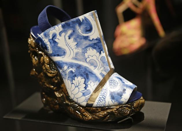 "This Feb. 11, 2013 photo shows a shoe designed by Nicholas Kirkwood for the Rodarte spring 2011 fashion show that has the appearance of antique ceramic ware is displayed at the ""Shoe Obsession"" exhibi"