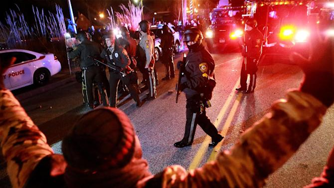Police and protesters meet at a line on South Florissant Avenue on Monday, Nov. 24, 2014, in Ferguson, Mo., after a grand jury did not indict Ferguson police Officer Darren Wilson in the shooting death of unarmed, 18-year-old Michael Brown. (AP Photo/St. Louis Post-Dispatch, Christian Gooden)  EDWARDSVILLE INTELLIGENCER OUT; THE ALTON TELEGRAPH OUT