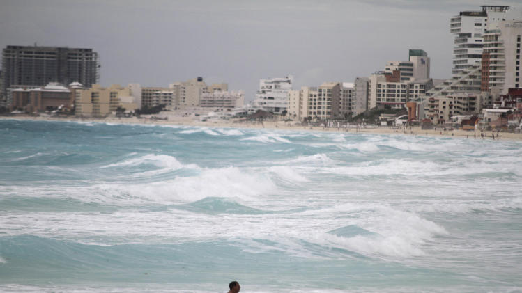 A man swims after the passage of Tropical Storm Don at the Gaviota Azul beach in Cancun, Mexico,Thursday, July 28, 2011. Don is over the central Gulf of Mexico but the system is not expected to become a hurricane as it moves toward southeastern Texas. (AP Photo/Israel Leal)