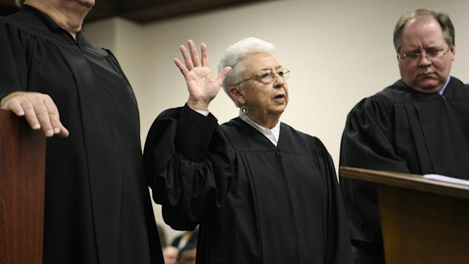In a 2011 photo Sadie Holland takes the oath of office for Justice Court Judge during the swearing in ceremony at the Lee County Justice Center in Tupelo, Miss. The letter containing ricin sent to Holland was the only one to make into the hands of an intended target.  (AP Photo/Northeast Mississippi Daily Journal, C. Todd Sherman)