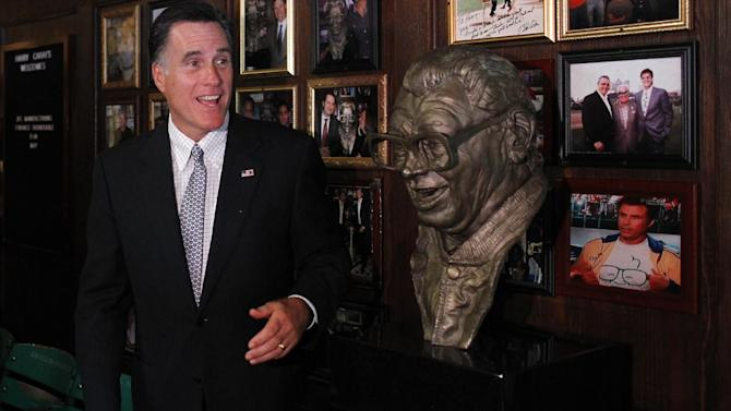 Republican presidential candidate, former Massachusetts Gov. Mitt Romney poses with a bust of  famed baseball announcer, Harry Caray, after a private fundraising event at Harry Caray's Italian Steakhouse restaurant in Chicago, Tuesday, Aug. 7, 2012. (AP Photo/Charles Dharapak)