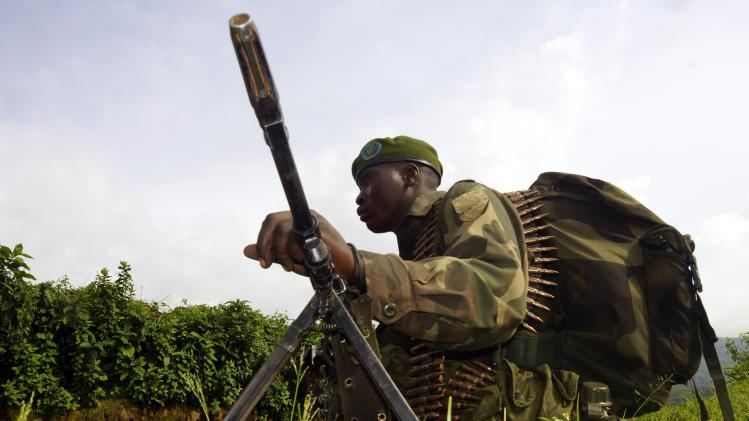 Congolese soldier holds position against the M23 rebels near the Bunagana north of Goma