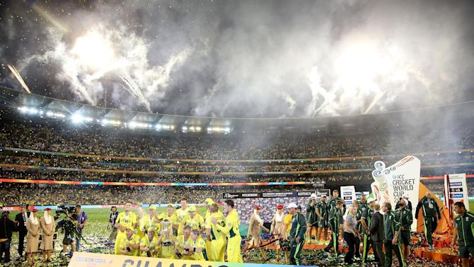 Fireworks explode around the Melbourne Cricket Ground as the Australian team celebrate their seven wicket win over New Zealand in the Cricket World Cup final in Melbourne, Australia, Sunday, March 29, 2015. (AP Photo/Rick Rycroft)
