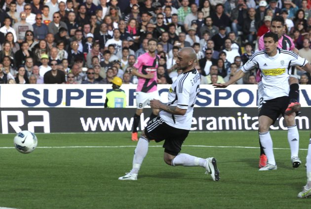 Juventus' Borriello shoots and scores against Cesena during their Italian Serie A soccer match at the Manuzzi stadium in Cesena