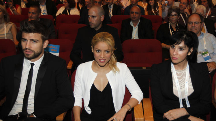 Colombian singer Shakira, center, sits with her boyfriend FC Barcelona Gerard Pique, left, and U.S. comedian Sarah Silverman during a plenary session at the President's Conference in Jerusalem, Tuesday, June 21, 2011. Colombian pop singer Shakira promoted her global education campaign with a stop at a joint Israeli-Arab school in Jerusalem on Tuesday. Kicking off Israel's third annual President's Conference on Tuesday with a plea for children's education worldwide, Shakira, a U.N. Goodwill Ambassador, said the Holy Land was the