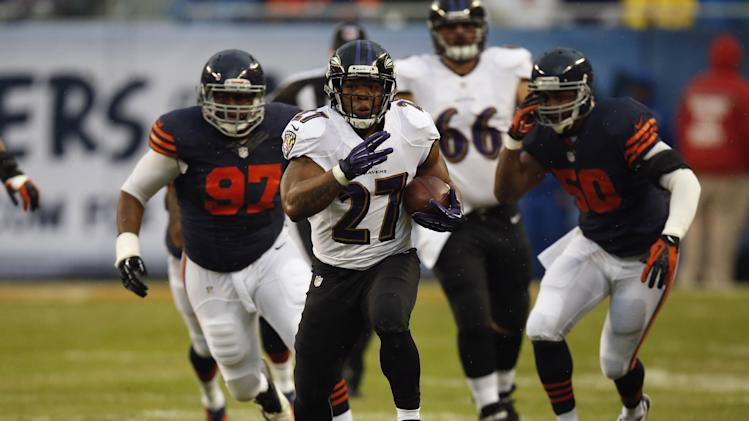 Baltimore Ravens running back Ray Rice (27) rushes past Chicago Bears linebacker James Anderson (50) and defensive tackle Landon Cohen (97) during the first half of an NFL football game, Sunday, Nov. 17, 2013, in Chicago