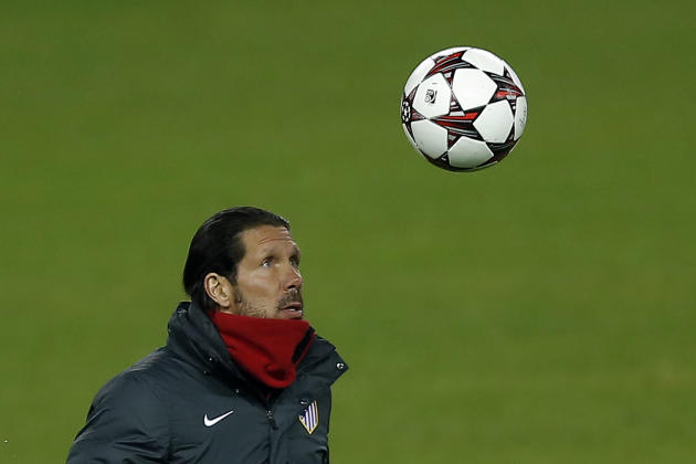 Atletico's coach Diego Simeone controls the ball during a training session in Madrid, Spain, Tuesday, Dec. 10, 2013. Atletico Madrid will play FC Porto in a Group G Champions League soccer match o
