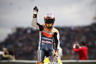 Australian rider Casey Stoner celebrates on his Honda after winning the Portugal MotoGP in Estoril. Stoner won the Portuguese MotoGP for his second successive victory this season, giving him a one point lead in the title race