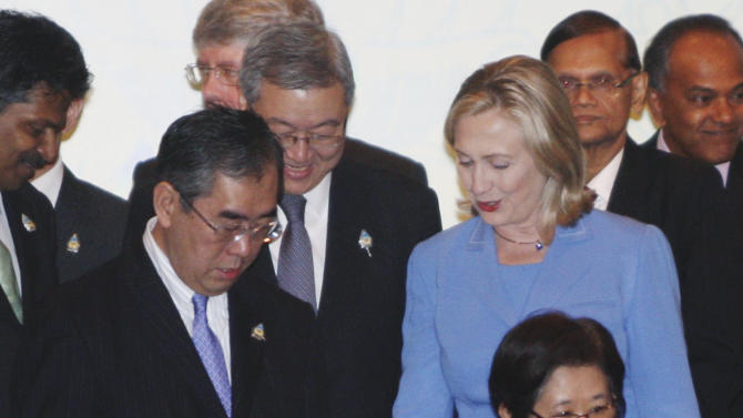 U.S. Secretary of State Hillary Rodham Clinton, in blue, talks with Japanese Foreign Minister Takeaki Matsumoto, center left, as North Korean Foreign Minister Pak Ui Chun, bottom, South Korean counterpart Kim Sung-hwan, behind Matsumoto, Thailand's Deputy Permanent Secretary of the Foreign Ministry Chitriya Pinthong, before Clinton, and other foreign ministers and officials walk by them prior to the ASEAN Regional Forum in Nusa Dua, Bali, Indonesia, Saturday, July 23, 2011. (AP Photo/Dita Alangkara)