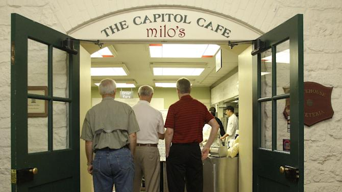 Patrons wait on line to eat lunch at the Statehouse cafe Monday, Aug. 1, 2011, in Columbus, Ohio.  State officials are debating a proposal to establish what would apparently be the nation's first statehouse bar.  (AP Photo/Jay LaPrete)