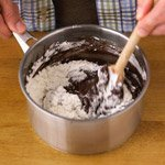 Stirring flour into chocolate mixture