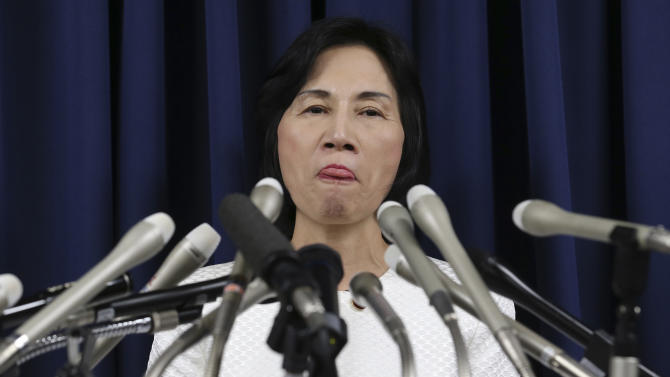 "Japan's Justice Minister Midori Matsushima gestures during a press conference to announce her resignation, at her ministry in Tokyo, Monday, Oct. 20, 2014. Matsushima resigned after the opposition Democratic Party of Japan filed a criminal complaint against her over distribution of hand-held fans, or ""uchiwa."" Matsushima is also facing complaints over using parliament-provided housing while keeping security guards at her private residence in downtown Tokyo.  (AP Photo/Koji Sasahara)"