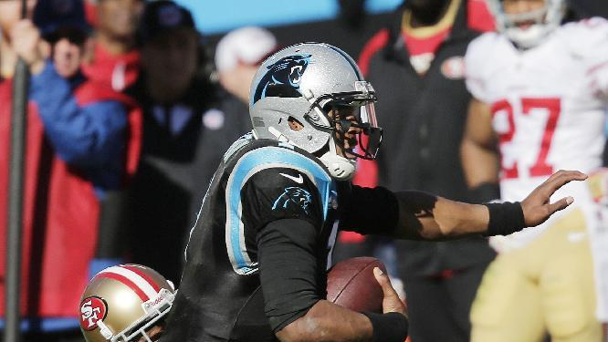In this Jan. 12, 2014, file photo,San Francisco 49ers strong safety Donte Whitner (31) tackles Carolina Panthers quarterback Cam Newton (1) during the first half of a divisional playoff NFL football game in Charlotte, N.C. The Panthers want fourth-year quarterback Cam Newton to throw more and run less as he continues to grow as an NFL quarterback. That's because they want the two-time Pro Bowler to stay healthy