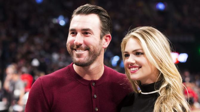 FILE - This is a Feb. 14, 2016 file photo showing Detroit Tigers pitcher Justin Verlander and model Kate Upton posed during halftime at the NBA All-Star basketball game  in Toronto. Upton has announced her engagement to baseball star Justin Verlander. The 23-year-old supermodel and actress took to the red carpet at Monday night's, May 2, 2016 Met Gala in New York City to show off her ring. (Mark Blinch/The Canadian Press via AP, File) MANDATORY CREDIT