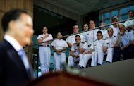 Cadets watch US Republican presidential candidate Mitt Romney (L) deliver a foreign policy speech at the Virginia Military Institute in Lexington, Virginia
