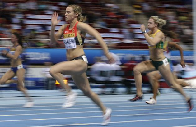 Germany's Verena Sailer, left, and South Africa's Carina Horn, right, compete in a women's 60m heat during the Athletics Indoor World Championships in Sopot, Poland, Saturday, March 8, 201