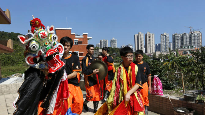 A qilin dance troupe performs at a village in Hong Kong Monday, Feb. 11, 2013, to celebrate the start of the Chinese Lunar New Year of Snake. (AP Photo/Vincent Yu)