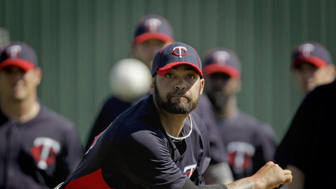 Minnesota Twins relief pitcher Joel Zumaya throws a pitch during a baseball spring training workout Friday, Feb. 24, 2012, in Fort Myers, Fla. (AP Photo/David Goldman)