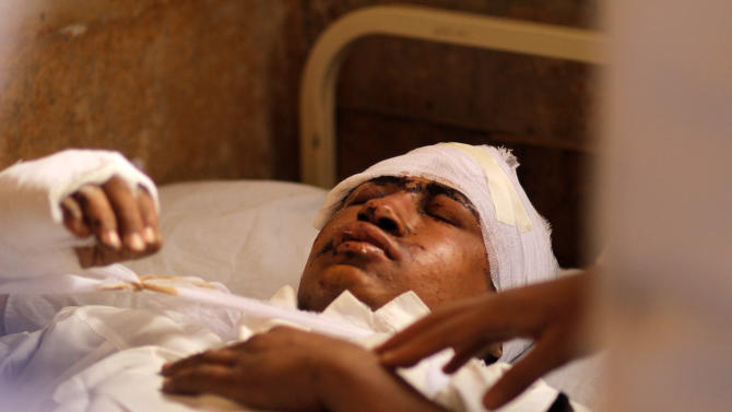 An injured Egyptian is treated at a hospital following a train crash in Badrasheen, 40 KM South Cairo, Egypt, Tuesday, Jan. 15, 2013. At least 19 people died and more than 100 were injured when two railroad passenger cars derailed just south of Cairo, health officials say. The accident comes less than two weeks after a new transportation minister was appointed to overhaul the rail system, and just two months after a deadly collision between a train and school bus. (AP Photo/Amr Nabil)