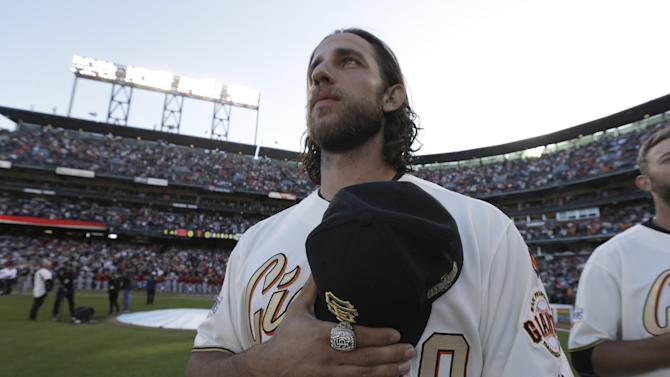 San Francisco Giants' Madison Bumgarner stands for the national anthem wearing his 2014 World Series championship ring before the baseball game against the Arizona Diamondbacks Saturday, April, 18, 2015, in San Francisco. (AP Photo/Ben Margot, Pool)