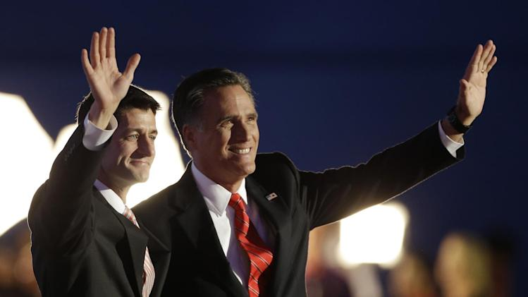 Republican vice presidential nominee, Rep. Paul Ryan, left and Republican presidential nominee Mitt Romney waves to delegates after his speech at the Republican National Convention in Tampa, Fla., on Thursday, Aug. 30, 2012. (AP Photo/Charlie Neibergall)