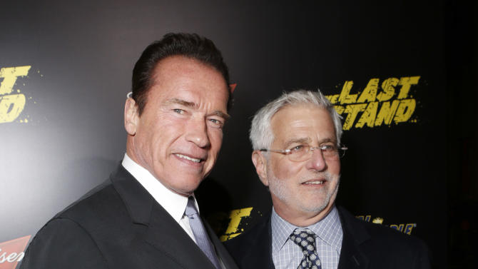 """Arnold Schwarzenegger and Co-Chairman of Lionsgate Motion Picture Group Rob Friedman attend the LA premiere of """"The Last Stand"""" at Grauman's Chinese Theatre on Monday, Jan. 14, 2013, in Los Angeles. (Photo by Todd Williamson/Invision/AP)"""