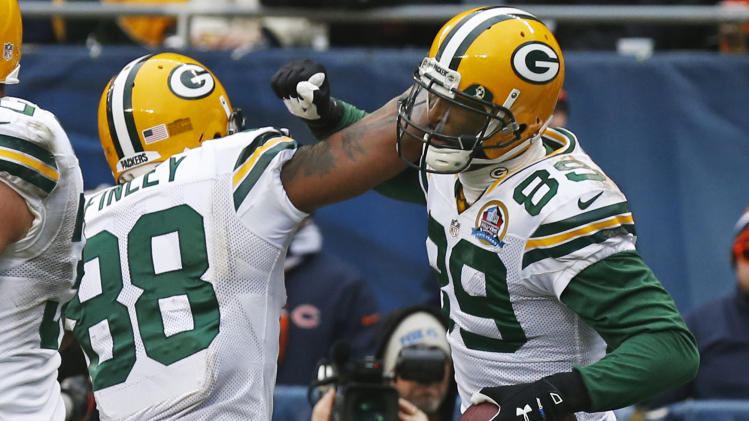 Green Bay Packers wide receiver James Jones (89) celebrates his touchdown reception with teammate Jermichael Finley (88) in the second half of an NFL football game in Chicago, Sunday, Dec. 16, 2012. (AP Photo/Charles Rex Arbogast)