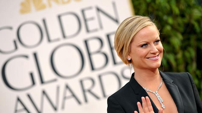 Amy Poehler arrives at the 70th Annual Golden Globe Awards at the Beverly Hilton Hotel on Sunday Jan. 13, 2013, in Beverly Hills, Calif. (Photo by John Shearer/Invision/AP)